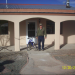 Mr. Hawkins in front of his repaired hom